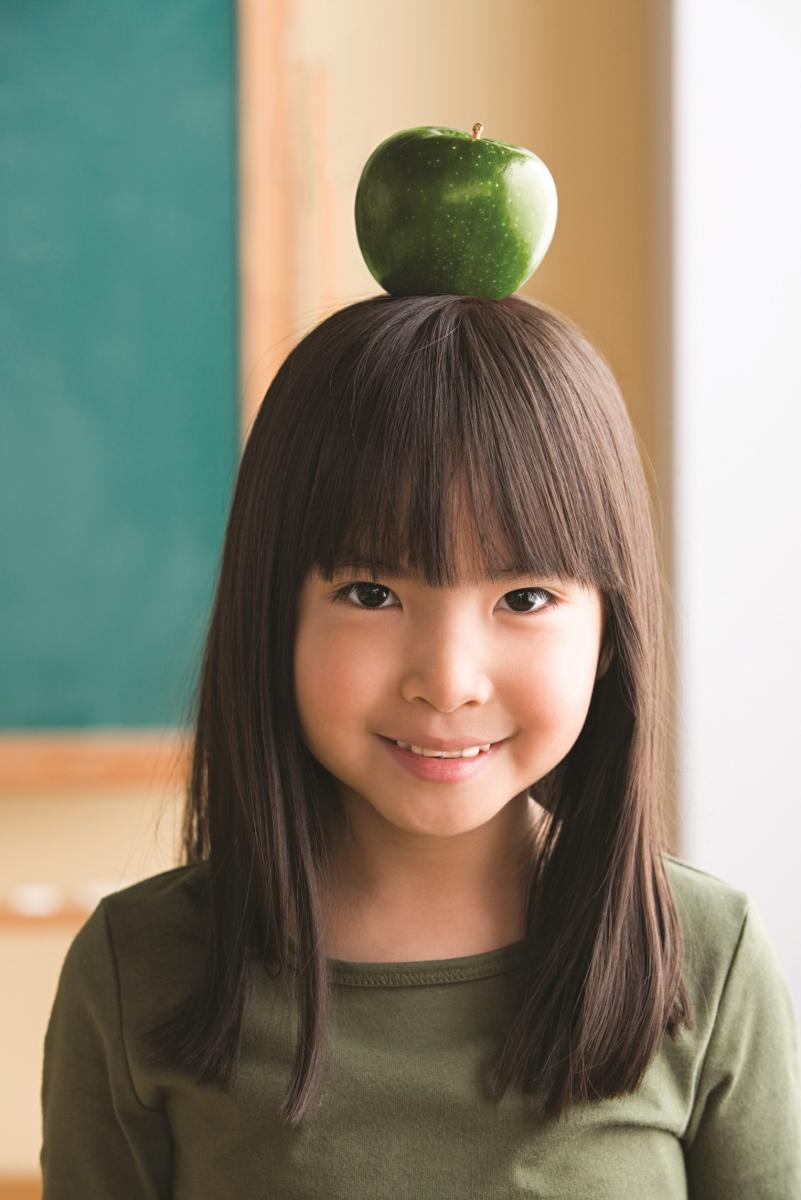 Girl with an apple on her head.