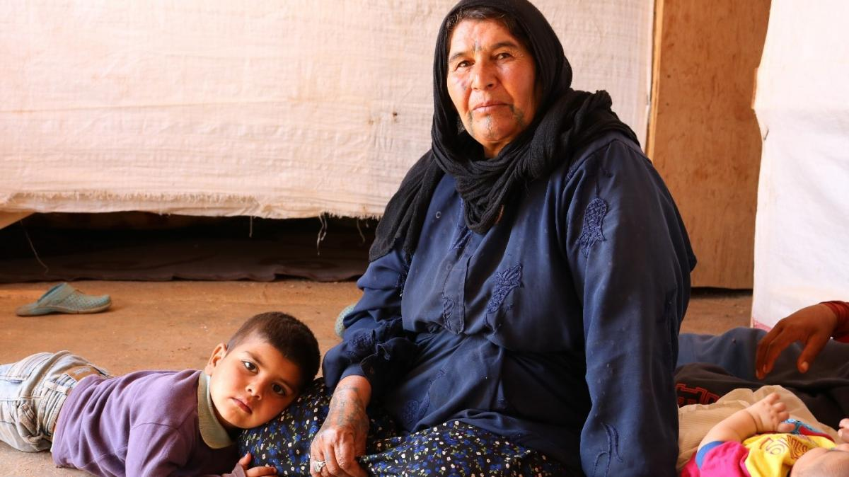 Turkia and her grandson in the Saide Refugee Settlement in Lebanon