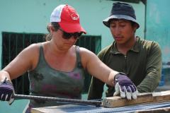 Woman working with Guatemalan in construction.